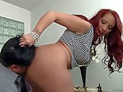 Curvy redhead Kelly Divine smothers a guy with her Big booty