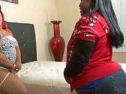 Two ebony whores take turns giving hung black stud a great blow job