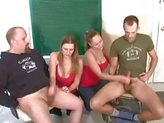 Two brunettes are taking turns on each guy jerking their cocks