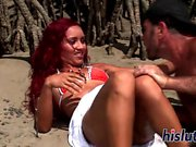 Gorgeous redhead gets nailed on the beach