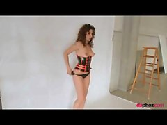 Latex corset on girl with curly red hair
