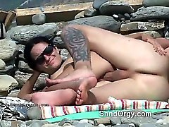 Babe rides cock on public nude beach