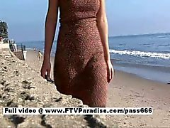Liliana gorgeous brunette girl walking on the beach then to a table