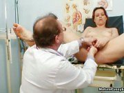 Doctor inspecting a mom pussy