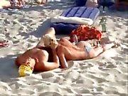 Blowjob on a public beach