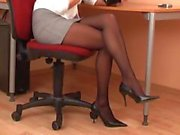Sexy secretary in black pantyhose