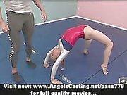 Adorable blonde teen cheerleader training with her teacher