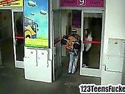 Teen brunette kissing a backpacker