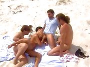 Sexy brunette Simone Horvath visits the gang bang beach and gets nailed