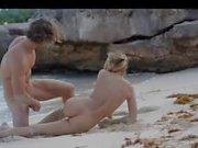 fluent art sex of horny couple on beach
