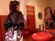 Curvy brunette Leanne Crow in front of the mirror