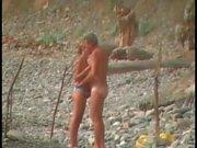 Bikini girl sucks cock on the beach