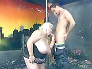 Huge pole dancer gets spooned by young guy