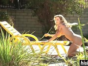 Cute girl spreads her legs outdoors