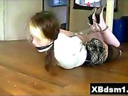 Her hands are behind her back in this XXX video