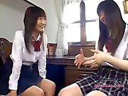 2 Schoolgirls Kissing Spitting Patting While Sitting On The Chair In The Sitting Roo