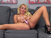 Wild blonde in high heels Aaliyah Love fucks herself with a purple toy
