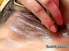 Busty Japanese babe Yuki Aida massaging her oiled body on