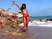 Sexy Ebony teasing on beach