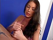 Long-haired brunette gives hand job while smoking cig