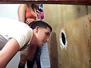 Amateur teens fucks through a gloryhole