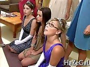 Gorgeous college teens suck on a strap on