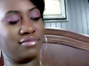 Busty black teen babe oils up
