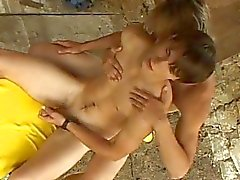 Two aroused gay dudes kissing and giving each other a handjob outdoor