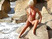 Naked blonde beauty on a beach
