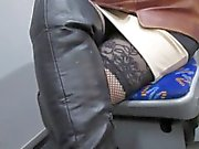 Girl in fishnet stockings and black leather boots in a bus
