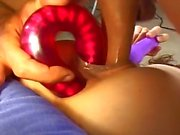 Kinky brunette stuffed with toys, dick and fist