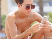 Pierced nipples spied on at the beach