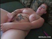 Tattooed lusty bitch pleasuring cunt with vibrator