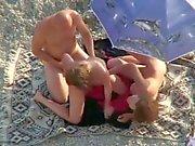 2 couples on the Beach filmed by a voyeur