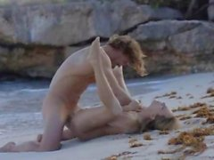 elegant art sex of horny couple on beach