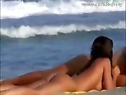 Voyeuring horny couple on a crowdy beach relaxing