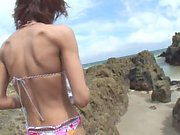 Randy brunette sucks guy's pole on the beach