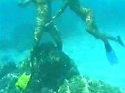 Skin Divers Underwater Frigging