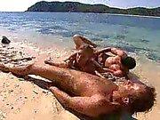 Double penetration with bikini girl at beach