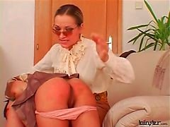 Spanked young lady sucks on mistress tits