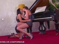 Busty lesbian coupke making out on the piano