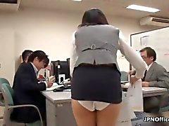 Sexy Asian slut showing off her panties at work