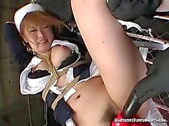Jap babe in maid dress gets toyed hard in BDSM