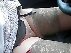 Girl changing pantyhose and stockings in a car