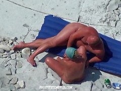 Mature woman fucking on the beach