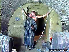 mature brunette whore gets chained and tortured