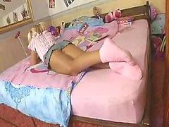 Teen in pink masturbates her pussy