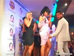 Watch champagne drinking ladies on the stage