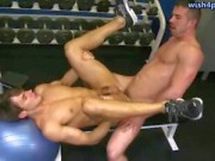 Two gays having anal sex in the gym