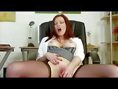Fabulous floozie with fiery red hair gets off at her office desk